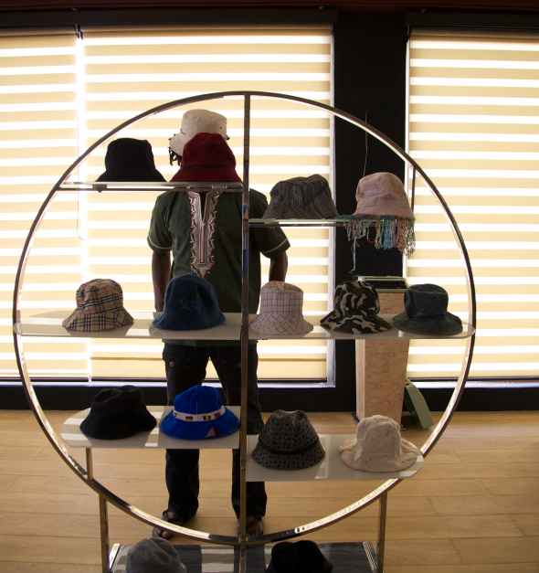 Anas Aremeyaw Anas and his hat collection.