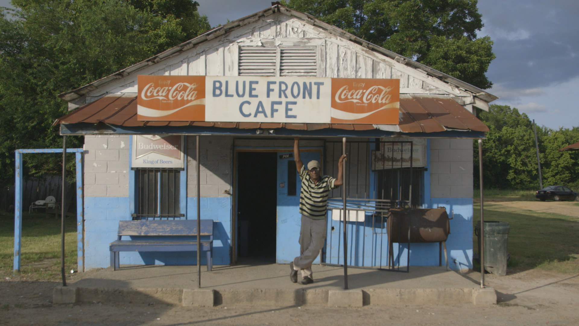 "Jimmy ""Duck"" Holmes in front of the Blue Front Cafe in Bentonia, Mississippi. (Still from I am the Blues. )"