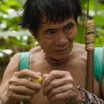 Penan leader Bala Tingang, holding a wild Borneo fruit, <em>bau baku tubu</em>.